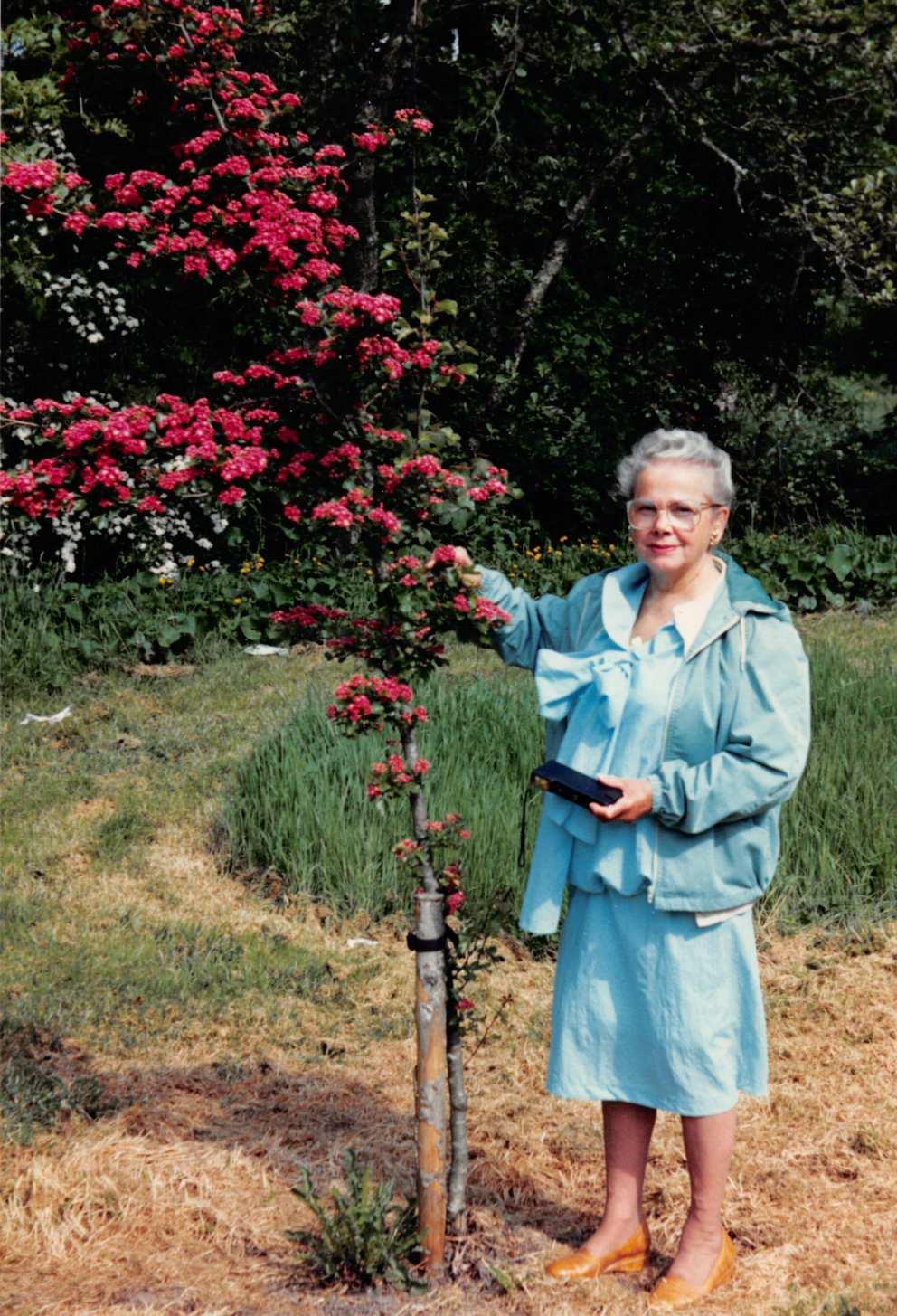 Ruth beside tree